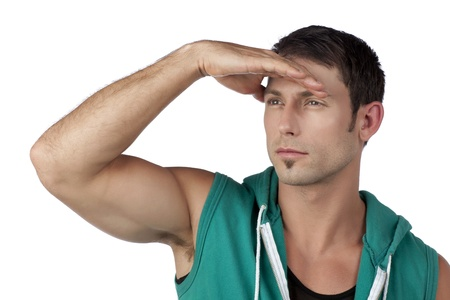 sleeveless hoodie: Muscular man looking for something against white backgrounds
