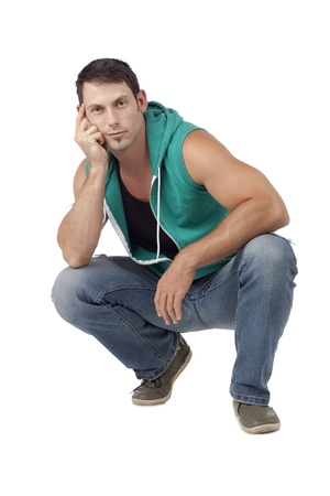 hooded vest: Portrait of muscular man sitting with hands on his face isolated on a white surface