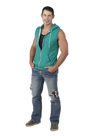 hooded vest: Portrait of muscular man wearing sleeveless hoodie while standing on a white background Stock Photo
