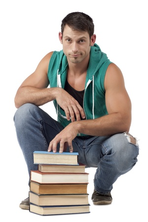 sleeveless hoodie: Portrait of muscular man with books sitting over the white surface Stock Photo
