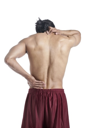 backpain: Mid adult man holding his painful neck and back