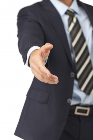Close up image of offering a shake hand against white background Stock Photo - 17400309