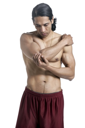 Man touching his painful elbow photo