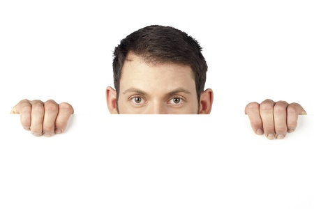 Man peeping over an empty white billboard