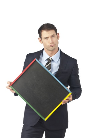 Portrait of pouting businessman holding an empty black board over a white background Stock Photo - 17367466