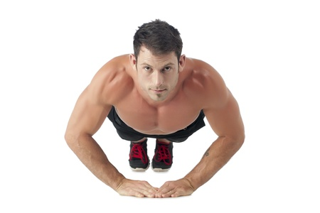Facade shot of a muscular man doing push up photo
