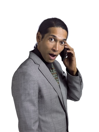 Portrait of shock businessman talking on the phone against white background Stock Photo - 17367230