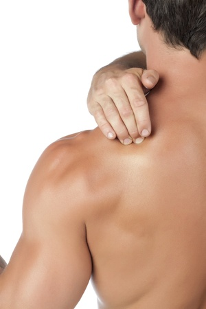 articulation: Portrait of man holding his shoulder as a sign of shoulder pain