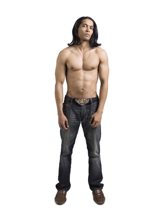 Portrait of topless muscular guy in jeans standing against white background photo