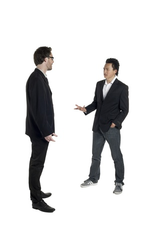 co work: Portrait of two businessmen discussing something over the white background