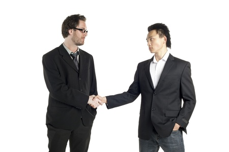 congratulating: Portrait of two men congratulating each other while standing on a white surface