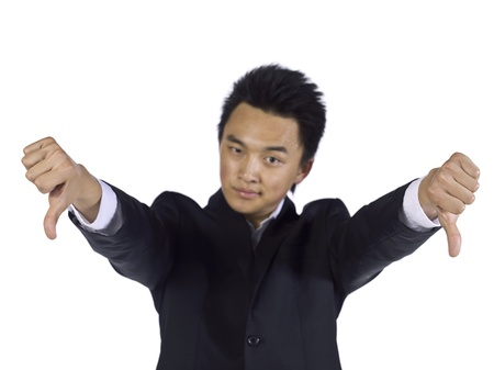 Disapproving businessman showing two thumbs down photo