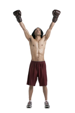 Full length image of a victorious Asian boxer raising his hands over a white background photo
