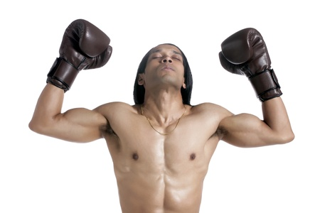 Image of victorious male boxer against white background photo