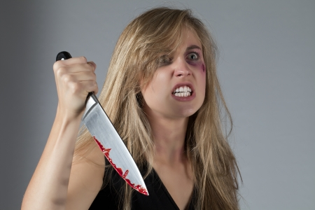 Image of abuse young woman holding a knife