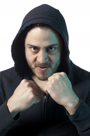 rabies: Angry Man Making Defiant Fists at Camera