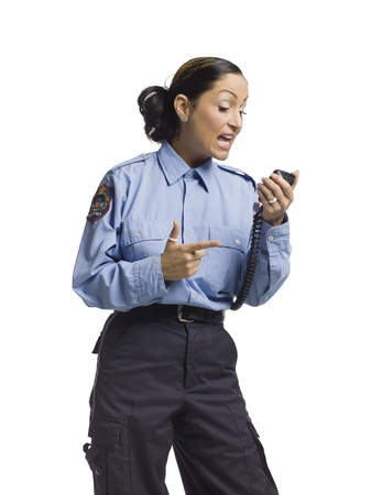 Angry policewoman talking through her radio photo