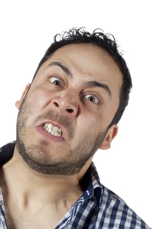 Close-up image of an angry man with his teeth grinding over the white background Stock Photo - 17377383