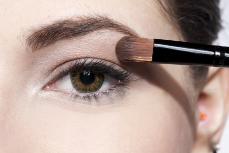 Close up image of woman applying eye shadow Stok Fotoğraf