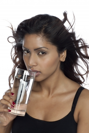 Close-up image of an Asian woman drinking water isolated on a white background photo