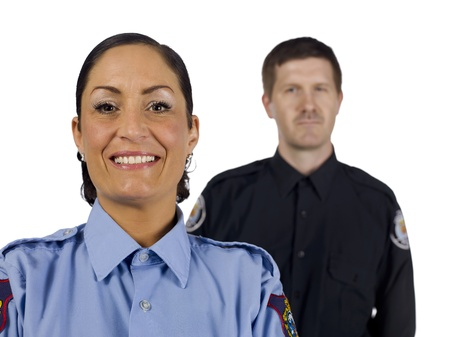 law enforcer: Close-up image of a happy policewoman with a policeman on her background