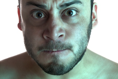 Close-up image of a man with an angry facial expression on a white background Stock Photo - 17377514
