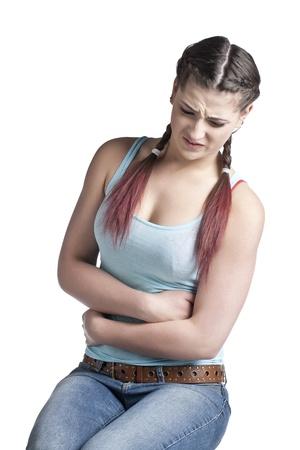 abdominal pain: Close-up immagine di una donna con dolore addominale isolato su sfondo bianco Archivio Fotografico