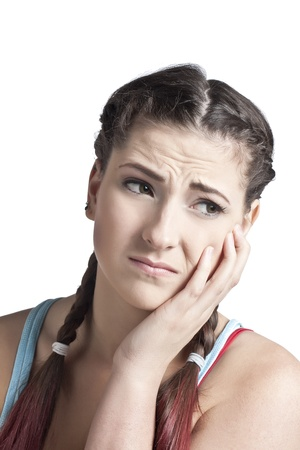 Close-up image of a woman with toothache isolated on a white background