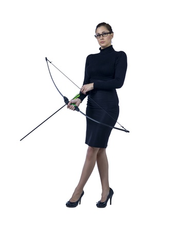 Full length portrait of beautiful businesswoman holding bow and arrow against white background