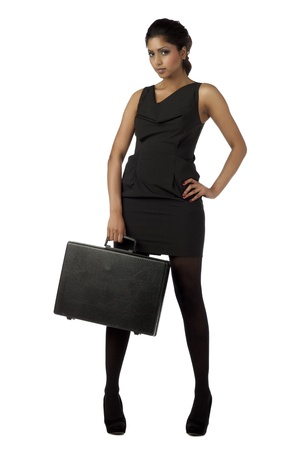 attache: Full length portrait of beautiful young lady with black attache case against white background