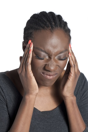 Portrait of black woman suffering headache against white background photo