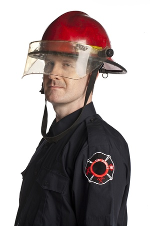 Portrait of a brave fireman wearing his uniform photo