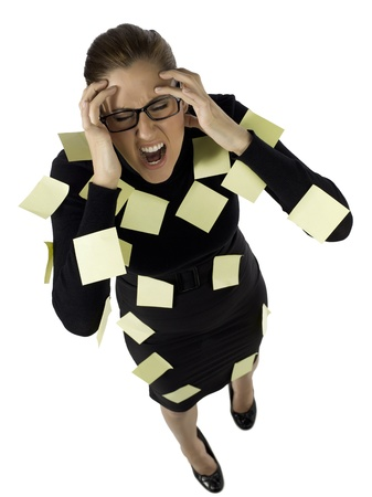 Portrait of a businesswoman with sticky notes on her body getting mad photo