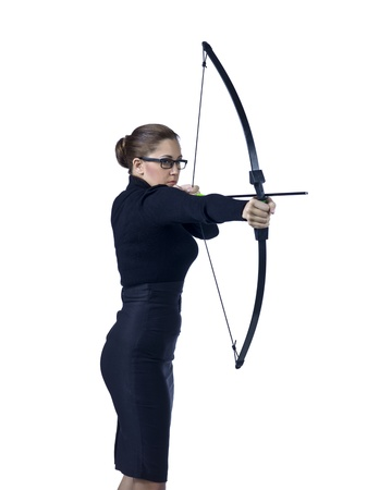 Close-up image of a businesswoman with archery hitting the target Stock Photo