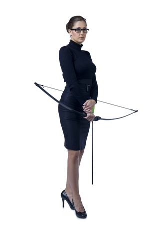 Full length image of a businesswoman holding a crossbow photo