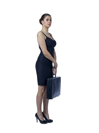 attache case: Full length portrait of businesswoman holding black attache case standing against white background