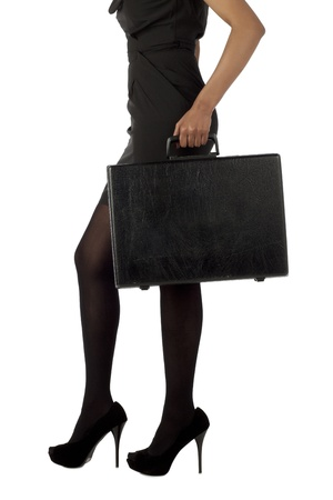 unrecognized: Unrecognized businesswoman holding suitcase standing on a white surface Stock Photo