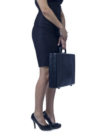 stride: Cropped image of businesswoman with black brief case against white background Stock Photo