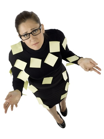 Overhead shot of the stressed businesswoman with sticky notes on the body photo