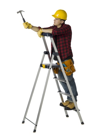 Image of a male carpenter on the ladder holding hammer photo