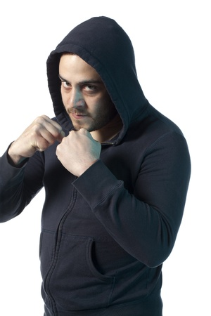 Caucasian man wearing a jacket with hood, about to punch Stock Photo - 17377413