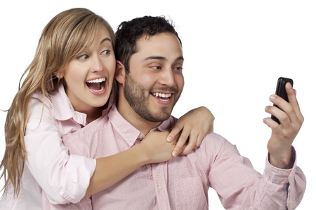 Happy smiling couple taking self portraits using a cell phone Stock Photo - 17377477