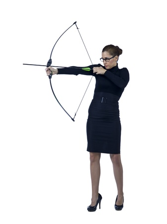 Full length image of a determined businesswoman aiming her bow to the target