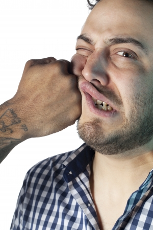 Portrait of face of man receiving a punch against white background photo