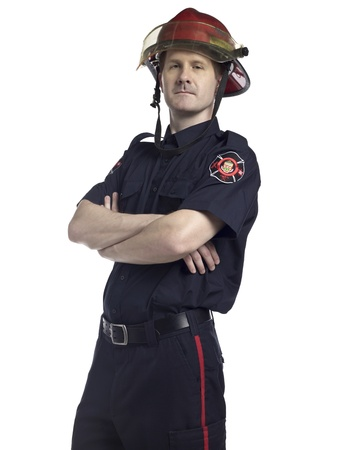 Portrait of a male firefighter with arm crossed against the white surface photo