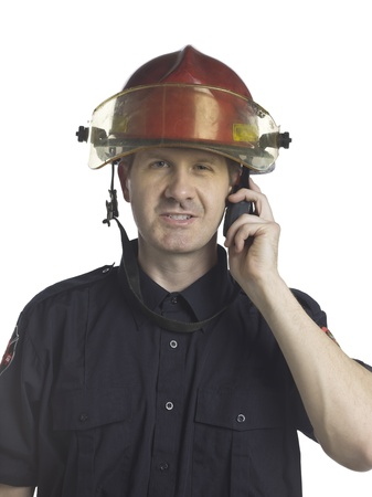 Mid-adult fireman reporting through his radio photo