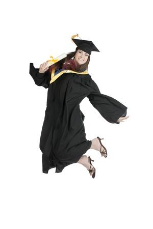흰색 배경에 대해 기쁨을 위해 학생은 점프 졸업의 초상화 스톡 콘텐츠