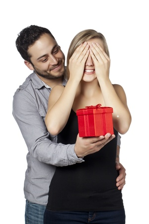 Close up image of guy giving a girl a surprise gift against white background Stock Photo - 17377405