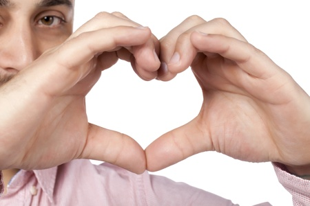 Image of a guy in-love showing a heart shaped using his hands photo