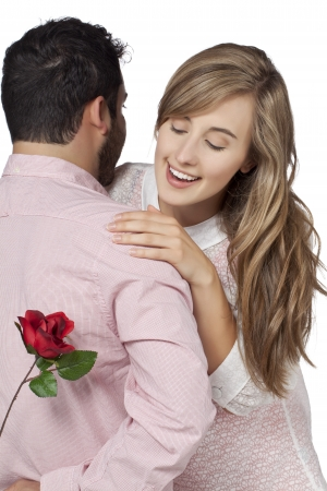 Image of guy surprising his girl by giving a flower photo